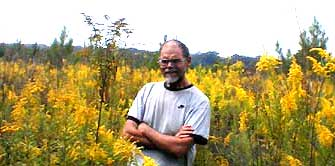 Naturalist Jim Conrad standing among some Canada Goldenrods, image by Karen Wise of Kingston, Mississippi